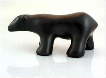 Image of walking polar bear sculpture in diamond black, profile facing the viewers left.