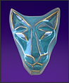 Image of brother cat mask in floating waterfall blue. Portrait facing the viewer.